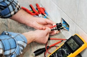 Penrith Electrical technician testing the voltage on a RCD