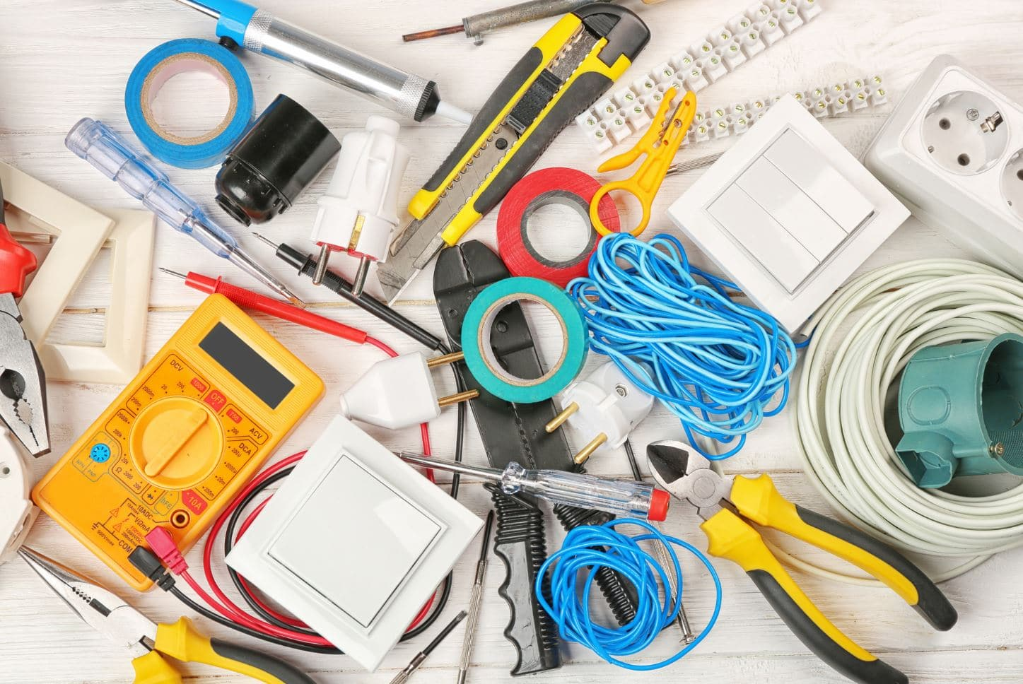 electrical tools scattered on the floor in an overhead shot